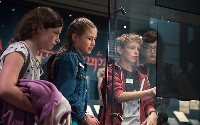 Group of children looking at an exhibition