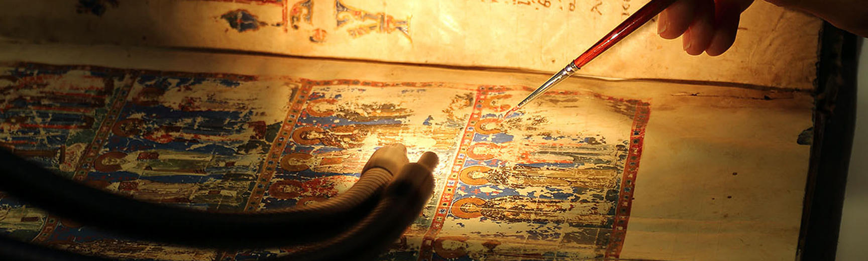 Conservation work on a faded manuscript