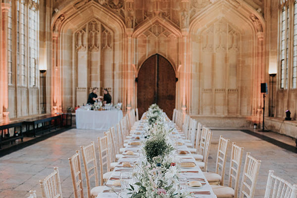 Table laid for wedding guests in Divinity School