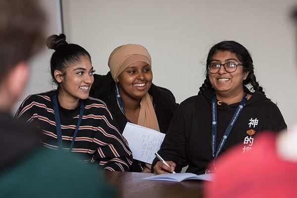Group of smiling students giving a presentation