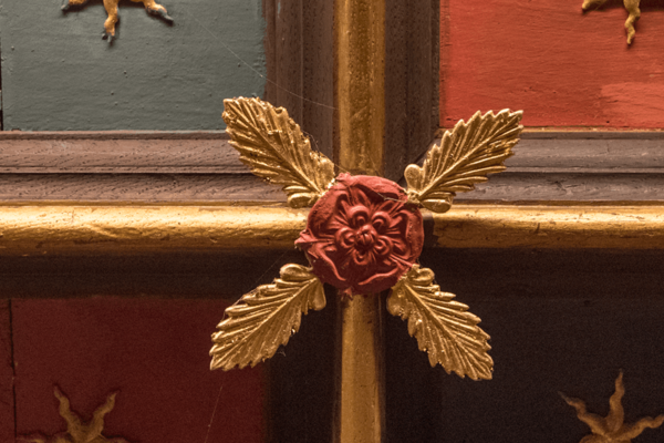 A painted rose on a panelled door