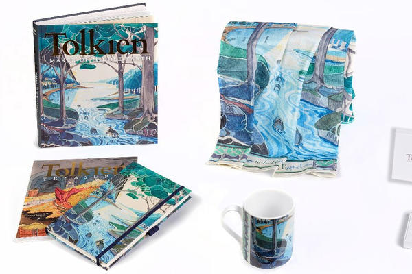 A book, scarf, mug and notebook all decorated with illustrations inspired by JRR Tolkien