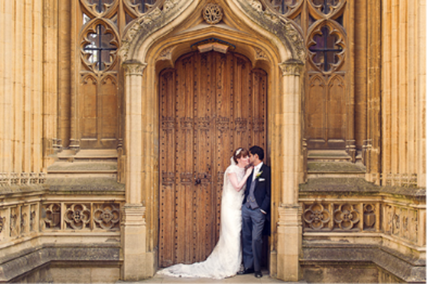 Wedding couple outside in arched doorway