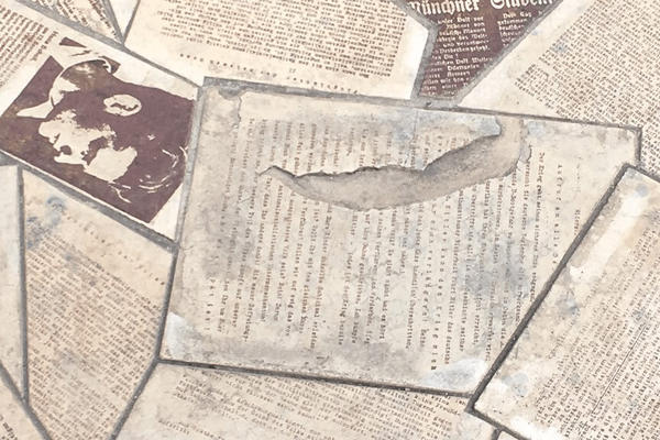 Newspaper cuttings on a stone floor