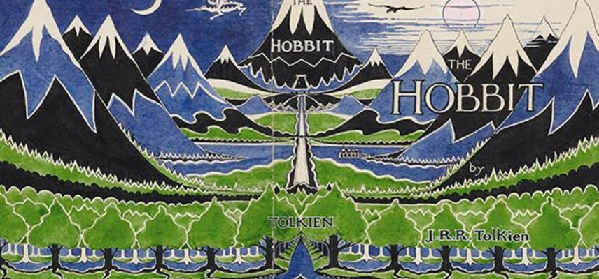 """An illustration of mountains and trees in green and yellow with the word """"Hobbit"""""""